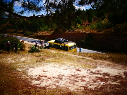 Our tour yellow (mini bus) at our picnic stop, parked by the road